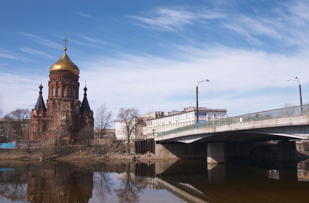 Gutuevskiy Bridge in Saint Petersburg with the Epiphany Churh
